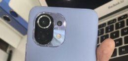 Photo shows Xiaomi Mi 11 with leathery backside
